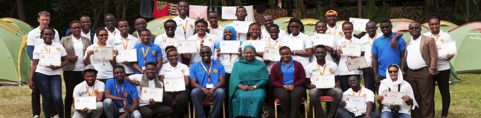group of people holding their certificate
